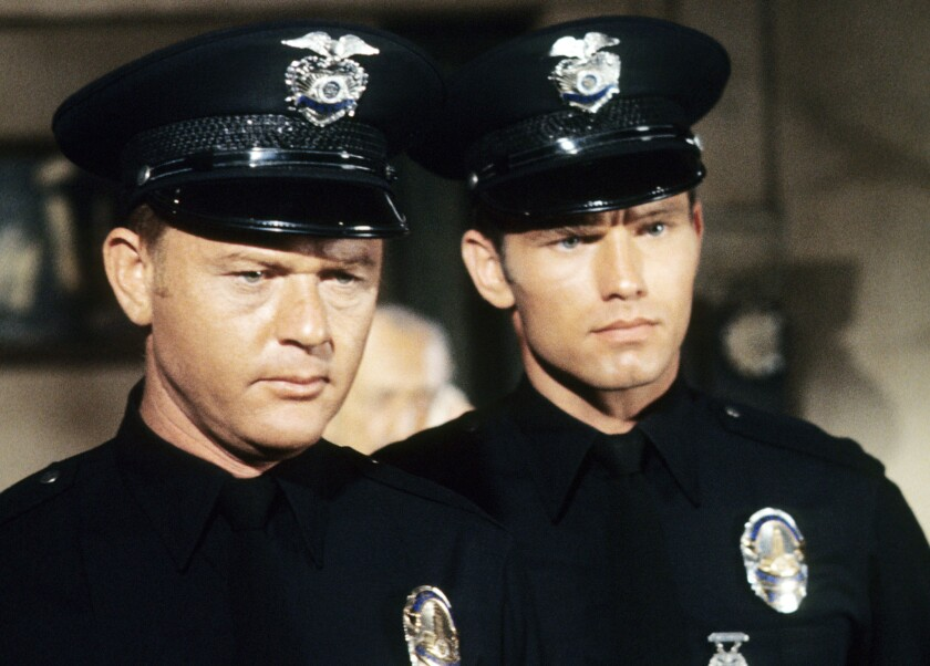 "Martin Milner, left, as Officer Pete Malloy and Kent McCord as Officer Jim Reed in ""Adam-12."""