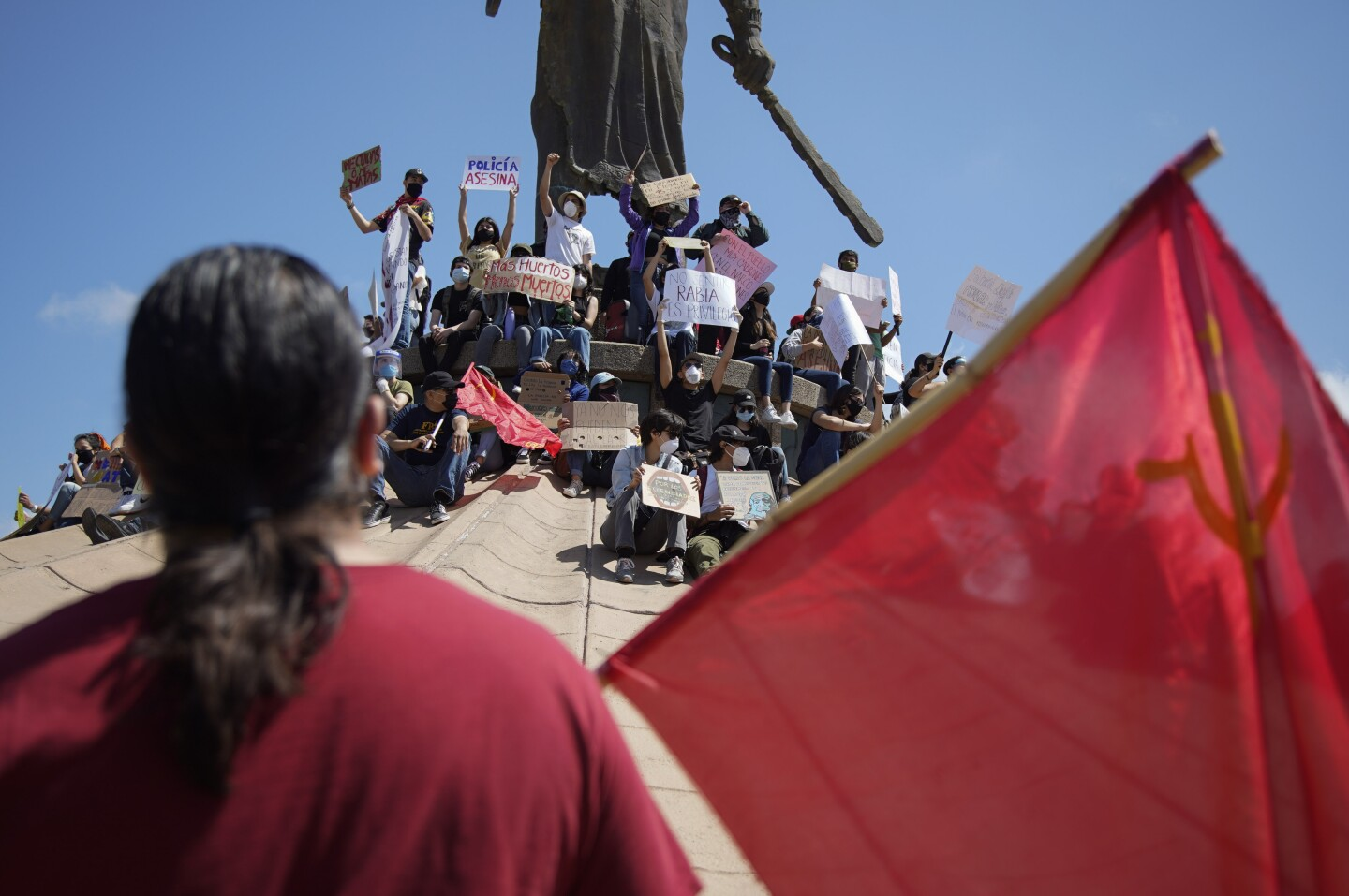 Protesters gather around the statue while others cheer from below. They gather at the Cuauhtemoc roundabout in Zona Rio, Tijuana June 7th,2020. The protesters gather to raise awareness to police brutality in Mexico and the United States.
