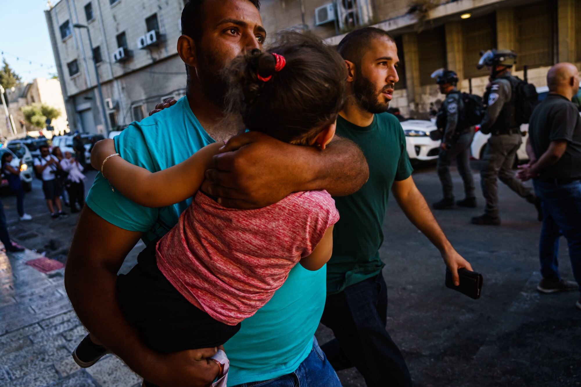 A man carries a child in his arms