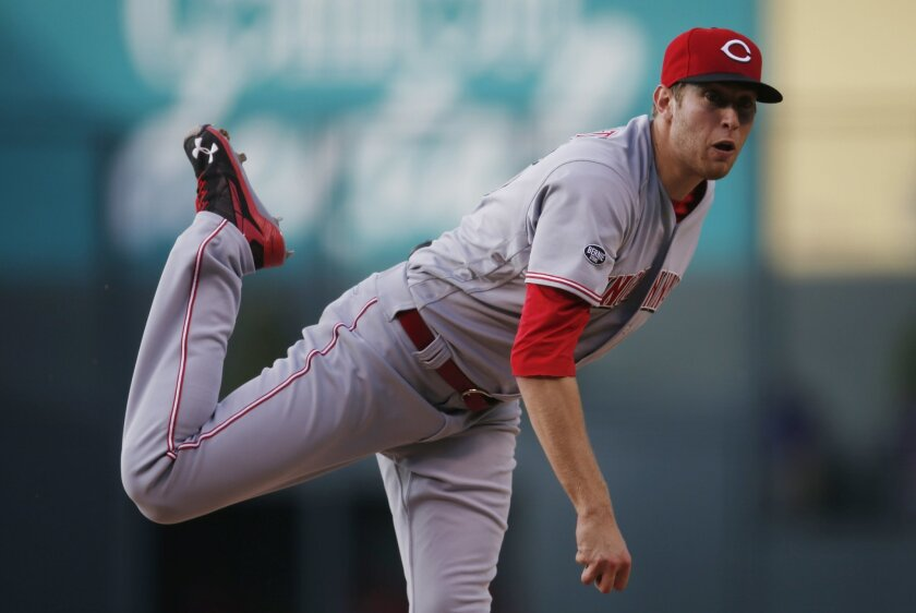 Cincinnati Reds starting pitcher Jon Moscot delivers a pitch to Colorado Rockies' Trevor Story in the first inning of a baseball game Tuesday, May 31, 2016, in Denver. (AP Photo/David Zalubowski)