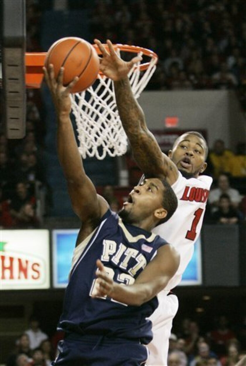 Louisville's Terrence Williams, right, comes over the top to try to block the shot attempt of Pittsburgh's Brad Wanamaker during the first half of an NCAA college basketball game in Louisville, Ky., Saturday, Jan. 17, 2009. (AP Photo/Ed Reinke)