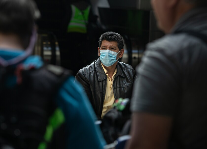 A man wearing a medical face mask