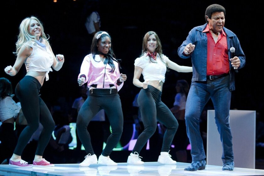 """Chubby Checker performs """"The Twist"""" with Detroit Pistons dancers during halftime an NBA basketball game against the Milwaukee Bucks Friday, April 13, 2012, in Detroit."""
