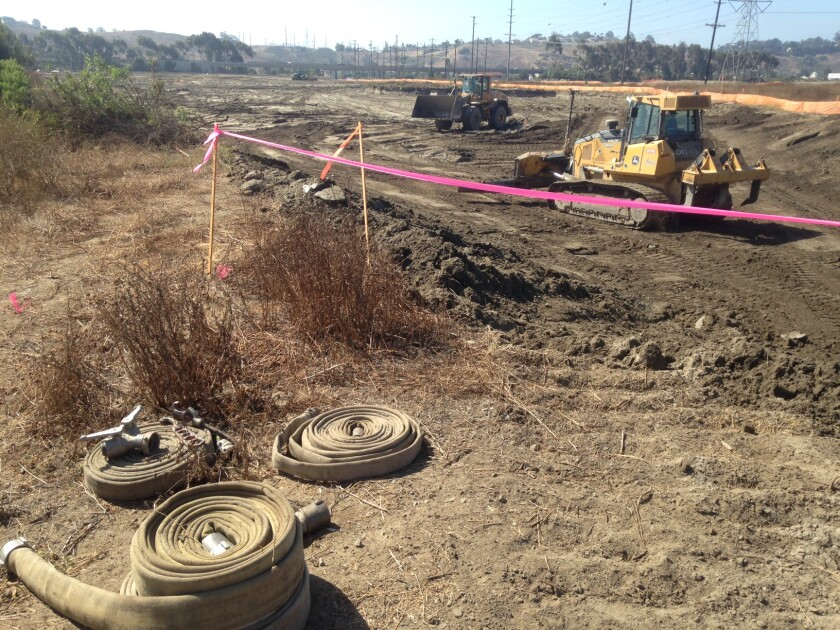 """Grading is underway for up to 700 homes, a 300-room hotel, stores, offices, a """"wave lagoon"""" and other attractions on the old Oceanside drive-in theater and swap meet site."""