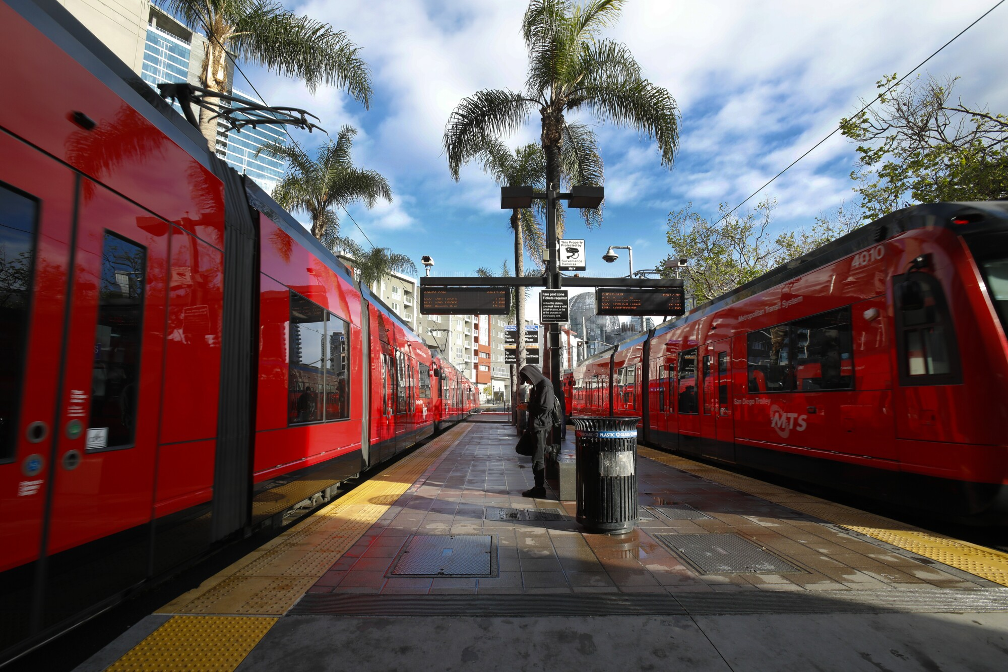 On Wednesday April 8, 2020, two almost empty trolley trains arrived and departed from the 12th and Imperial Transit Center in downtown, San Diego.