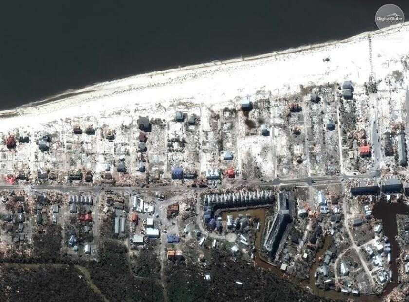 A handout satellite photo made available by DigitalGlobe on 13 October 2018 shows aerial view pier and a beach in Mexico Beach City, Florida, USA, 12 October 2018, after hurricane Michael hit the area. EFE/EPA/DIGITALGLOBE HANDOUT MANDATORY CREDIT: DIGITALGLOBE, A MAXAR COMPANY HANDOUT EDITORIAL USE ONLY/NO SALES