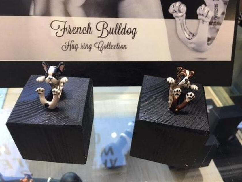 Whimsical 'Dog Fever' enamel rings are popular with canine owners at Diamonds on the Rock, 5630 La Jolla Blvd., (858) 750-2190.