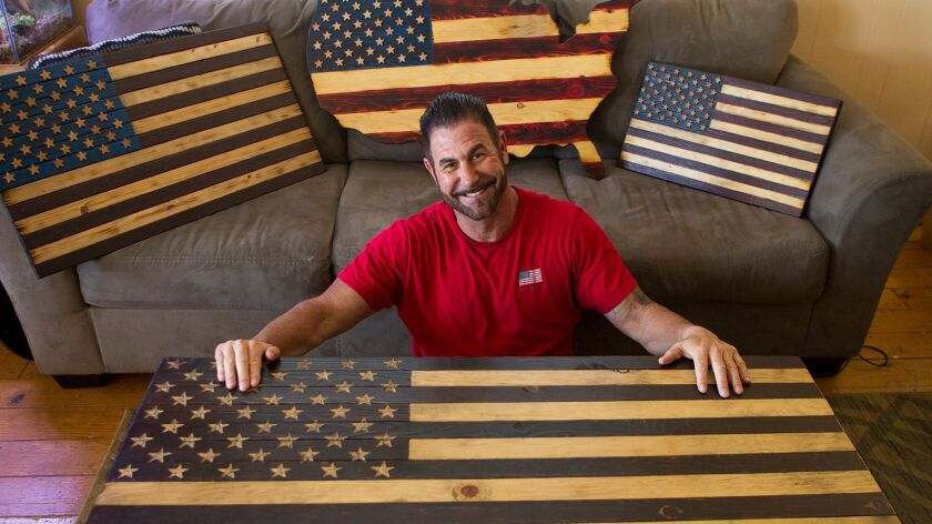 Brett Siciliano makes wooden American flags in his spare time out of his home in Huntington Beach. P