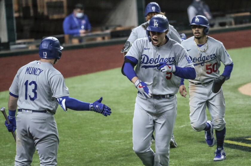 Corey Seager homers in the seventh inning inning in game five of the NLCS at Globe Life Field.