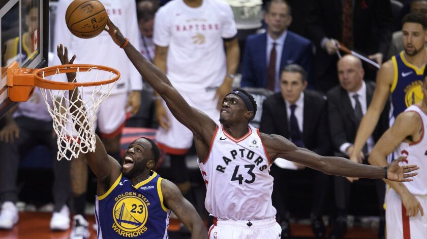 Toronto Raptors forward Pascal Siakam (43) blocks a shot by Golden State Warriors forward Draymond Green (23) during the second half of Game 1 of the NBA Finals on Thursday in Toronto.