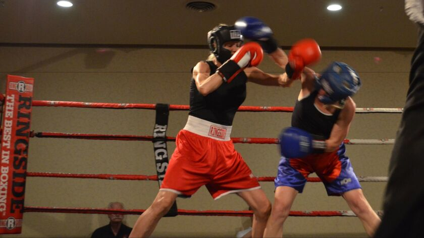 Janelle Freiman (left) trades punches during a March 23 fight at the Ringside Masters Championship i