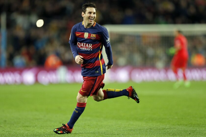 FC Barcelona's Lionel Messi reacts after scoring against Celta Vigo during a Spanish La Liga soccer match at the Camp Nou stadium in Barcelona, Spain, Sunday, Feb. 14, 2016. (AP Photo/Manu Fernandez)