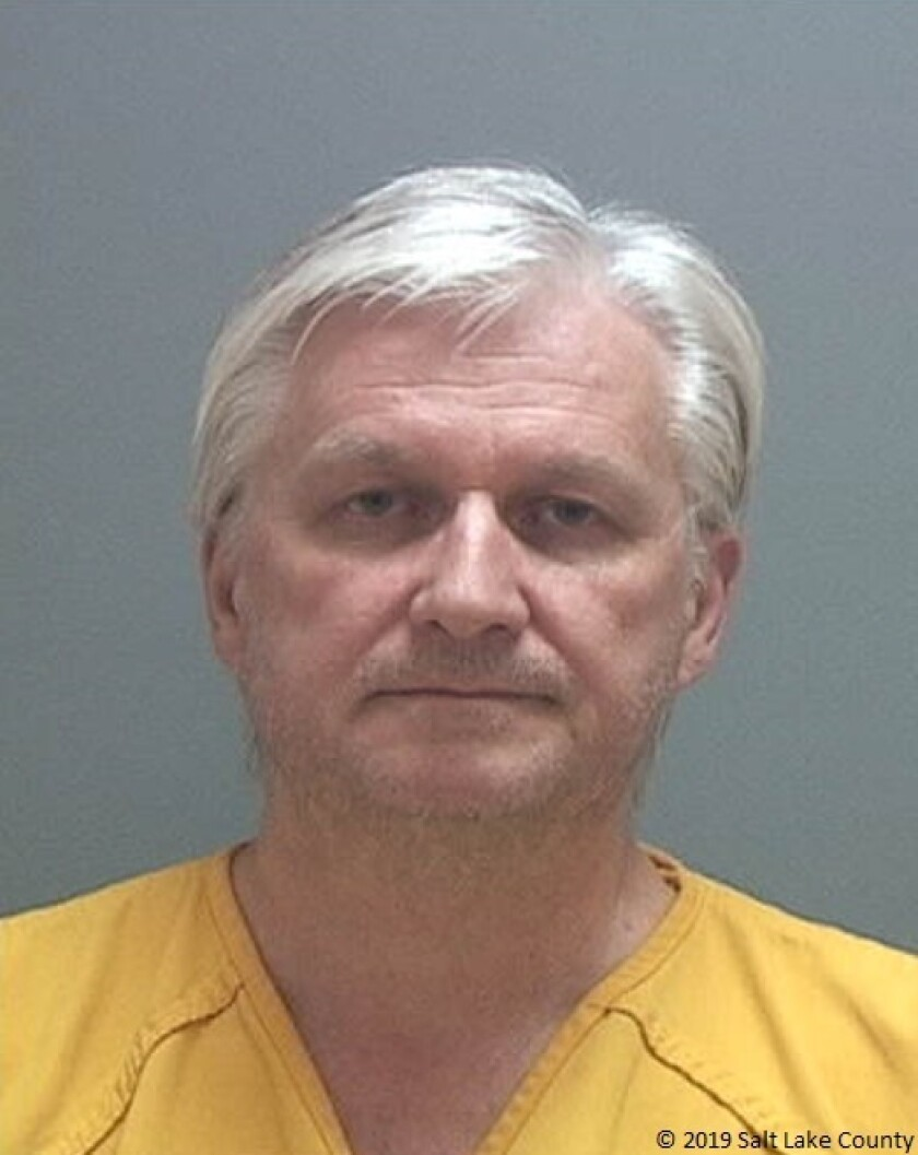 This photo released by the Salt Lake County Sheriff's Office shows Ron Rockwell Hansen, a former U.S. intelligence officer who pleaded guilty to trying to sell secrets to China. On Tuesday, Sept. 24, 2019, Hansen was sentenced to ten years in prison after admitting that foreign agents targeted him for recruitment. (Salt Lake County Sheriff's Office via AP)