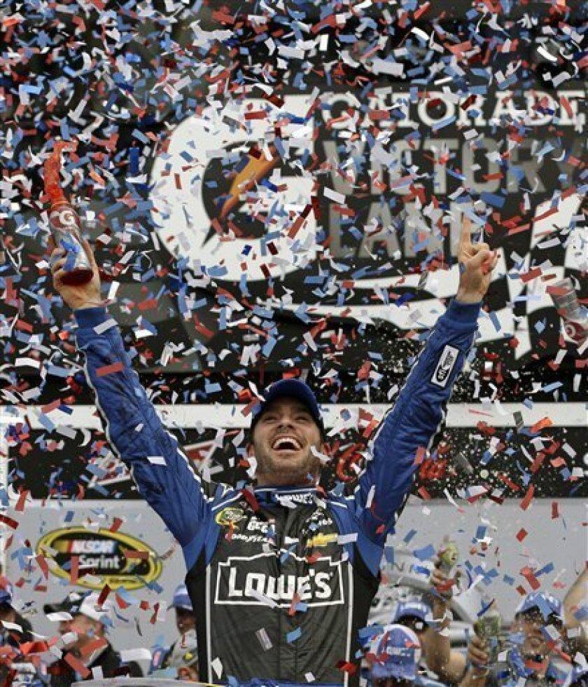 Jimmie Johnson celebrates in Victory Lane after winning the NASCAR Daytona 500 auto race at Daytona International Speedway, Sunday, Feb. 24, 2013, in Daytona Beach, Fla. (AP Photo/John Raoux)
