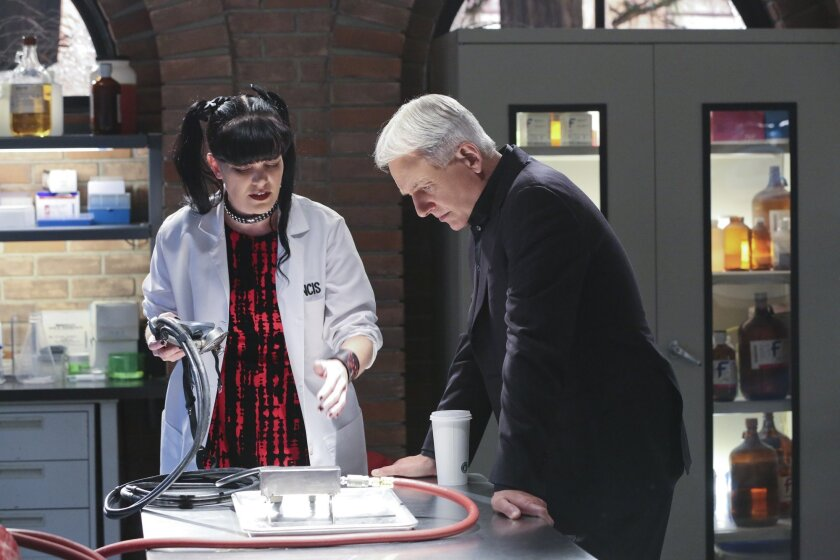 "In this image released by CBS,  Pauley Perrette, left, and Mark Harmon appear in a scene from ""NCIS.""  CBS dominated in the ratings last week with a winning slate of dramas and comedies as well as a Republican presidential debate, which ranked fourth. For the week of Feb. 8-12, the top 10 shows, th"