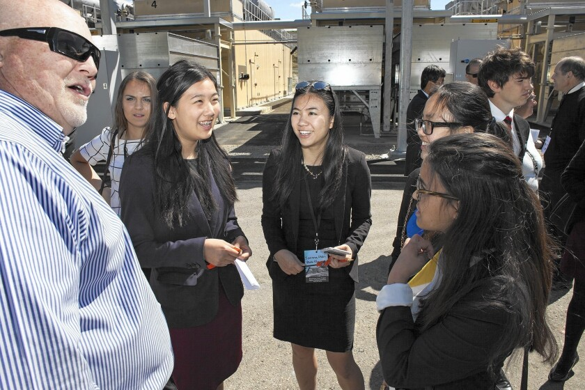 Woodbridge High School senior Joanna Chen, center, and other members of the YMCA Youth and Government program are led on a tour of the Bowerman Power Project gas-to-electricity facility by plant manager Brian Kelley, left, on Tuesday at Irvine's Bowerman Landfill.