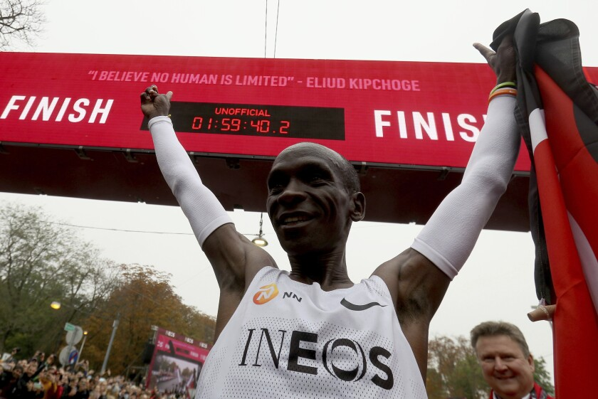 Marathon runner Eliud Kipchoge of Kenya celebrates after crossing the finish line at the INEOS 1:59 Challenge in Vienna on Oct. 12.