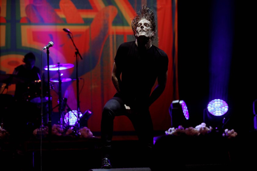 George Clarke onstage at the Wiltern with his metal band Deafheaven.
