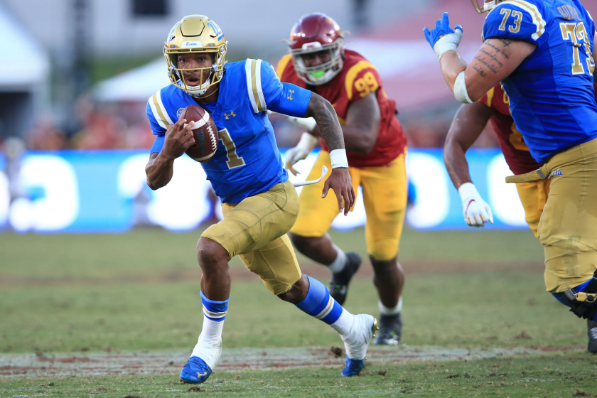 UCLA quarterback Dorian Thompson-Robinson scrambles against USC.