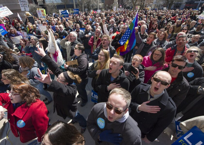 Thousands of opponents of Indiana Senate Bill 101, the Religious Freedom Restoration Act, gather for a protest last weekend. (AP Photo/Doug McSchooler)