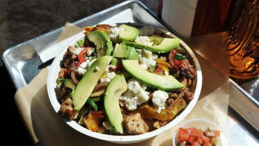 Chicken bowl with romaine lettuce, frijoles, grilled veggies, avocado and queso fresca served at Salud! (Rick Nocon)
