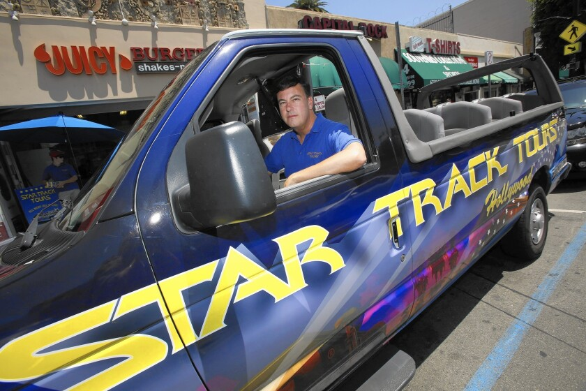 Tensions heat up among Hollywood tour bus operators