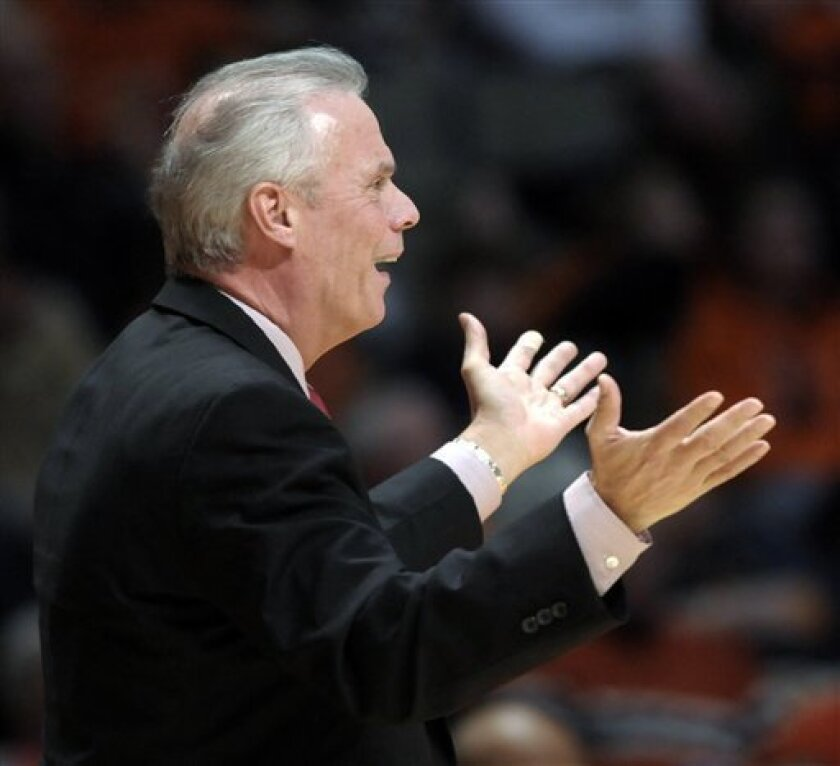 Wisconsin coach Bo Ryan questions a call in the first half of an NCAA college basketball game against Illinois at Assembly Hall in Champaign, Ill., on Sunday, Jan. 2, 2011. (AP Photo/John Dixon)