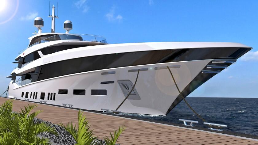 The Fisker 50 luxury yacht sits alongside a dock.
