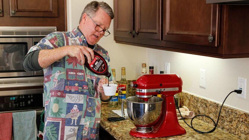 Rusty Tassinari makes eggnog at his home in Carlsbad.