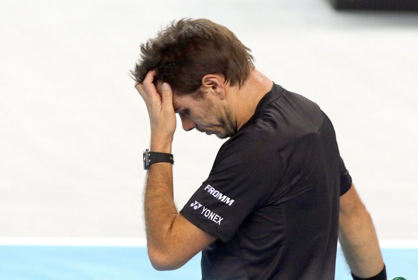 Stanislas Wawrinka of Switzerland reacts during his quarter final match against France's Benoit Paire, at the Open 13 Provence tennis tournament, in Marseille, southern France, Friday Feb. 19 , 2016. (AP Photo/Claude Paris)