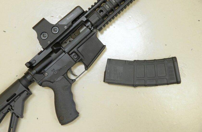 A semi-automatic rifle with a detachable magazine