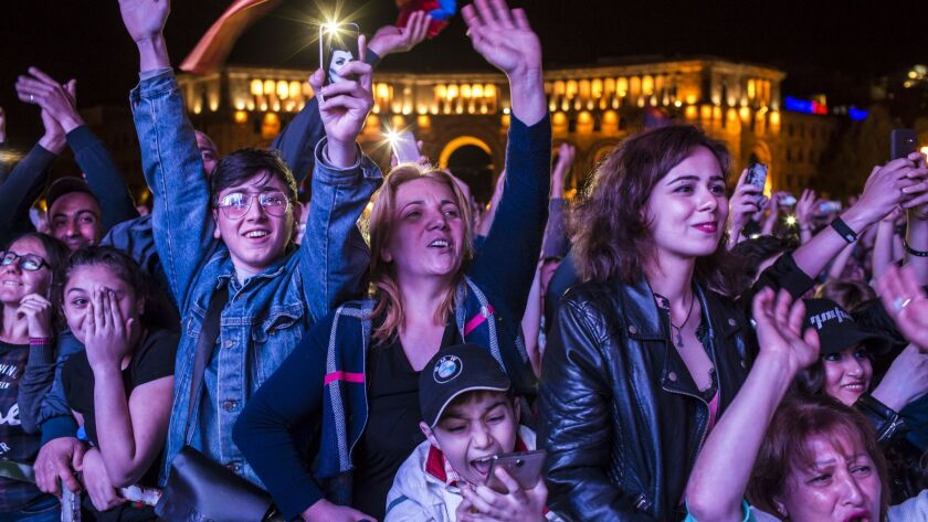 People cheer at a gathering in Yerevan, Armenia, to hear protest leader Nikol Pashinian speak on the eve of his expected election as prime minister.