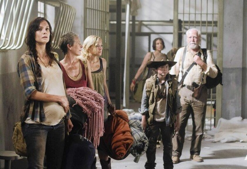 "Lori Grimes, left, met an untimely death on ""The Walking Dead,"" much to fans' delight."