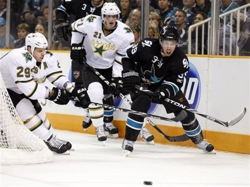 From left, Dallas Stars' Steve Ott and Loui Eriksson and San Jose Sharks' Logan Couture eye the puck during the first period of an NHL hockey game Thursday, March 31, 2011, in San Jose, Calif. (AP Photo/Ben Margot)
