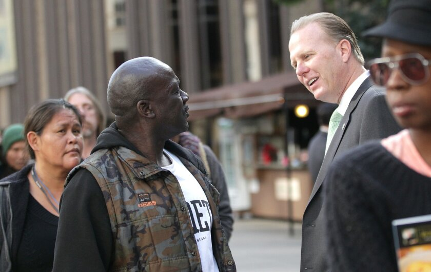 Mayor Kevin Faulconer was at Project Homeless Connect walking the line and meeting people like Steven Rhodes, left.