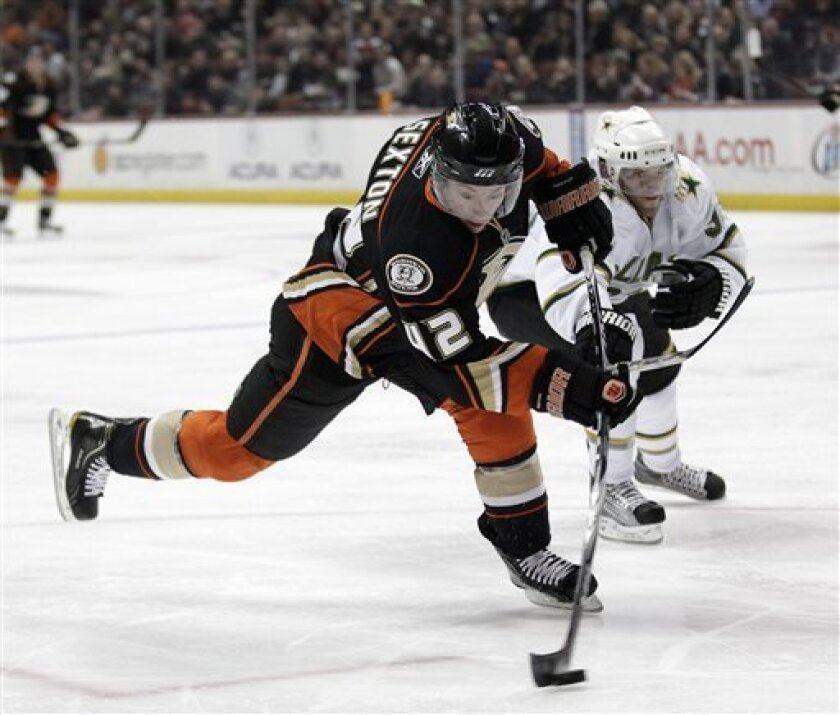 Anaheim Ducks right wing Dan Sexton shoots as Dallas Stars' Alex Goligoski defends in the second period of an NHL hockey game in Anaheim, Calif., Friday, March 4, 2011. (AP Photo/Jae C. Hong)