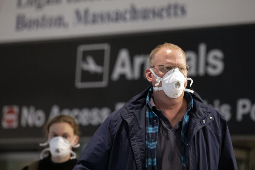 Passengers on a flight from Paris arrive at Logan International Airport in Boston, Friday, March, 13, 2020. Beginning at midnight Friday most Europeans will be banned from entering the United States for 30 days to try to slow down the spread of the coronavirus. Americans returning from Europe will be subject to enhanced health screening. For most people, the new coronavirus causes only mild or moderate symptoms, such as fever and cough. For some, especially older adults and people with existing health problems, it can cause more severe illness, including pneumonia. The vast majority of people recover from the new virus. (AP Photo/Michael Dwyer)