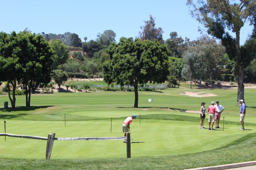 Golfers practice their short game at the RSF Golf Club (file photo from last year).