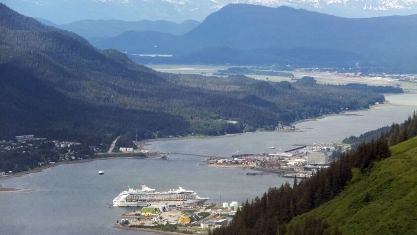 A cruise ship sits docked near downtown Juneau, Alaska.