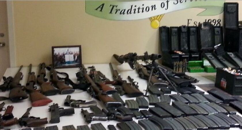Deputies seize weapons, White supremacist material