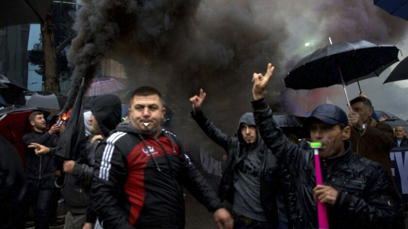 Protesters shout slogans during a rally in Tirana, Monday, May 13, 2019. Anti-government protesters