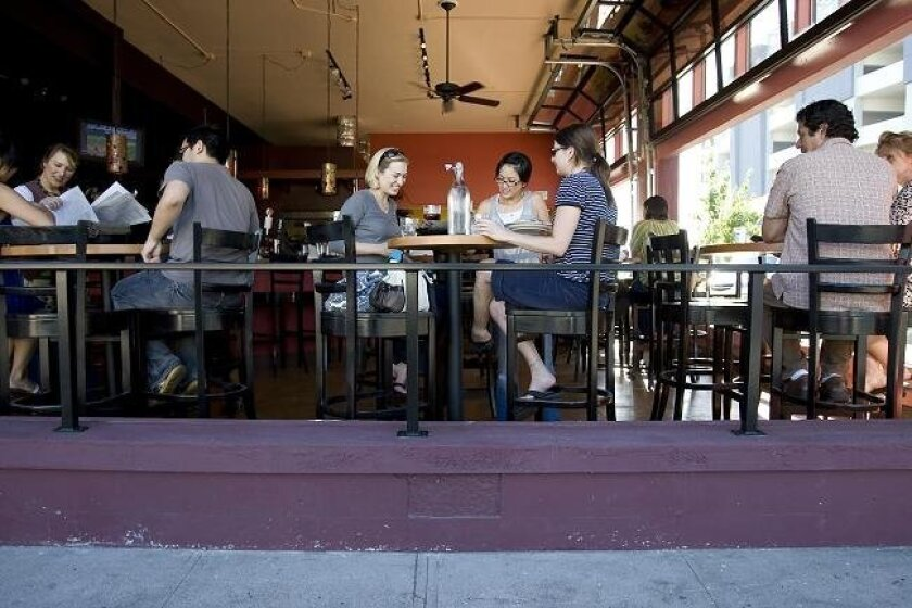 Customers at The Linkery (above) can continue to dine without fear of having to work out the tip percentage. The city attorney's office has had second thoughts about prosecuting the popular North Park restaurant for tacking on a surcharge rather than relying on tips.