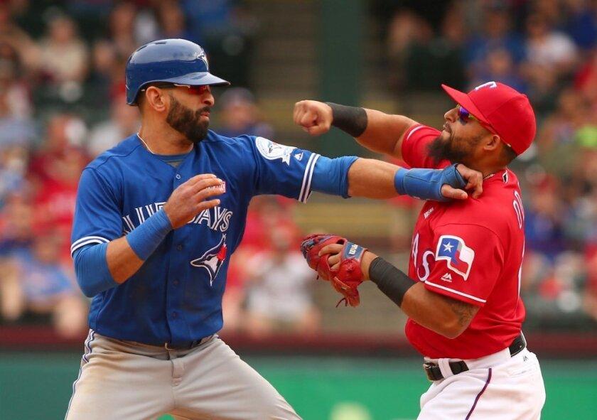 Bat-flip revenge? Watch Rangers' Rougned Odor punch Toronto's Jose Bautista in the face