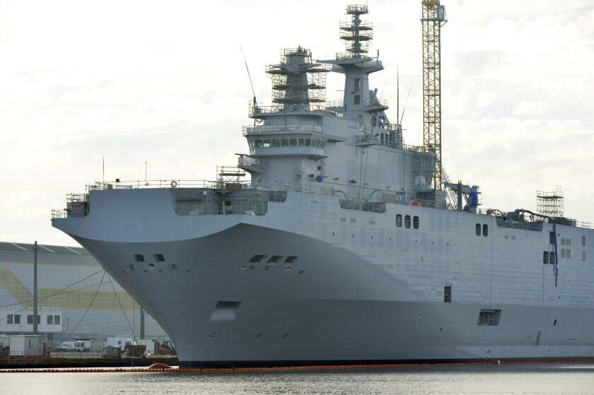 The Mistral-class assault vessel Sevastopol, the second of two warships France is building to sell to Russia, docked last week in the western French port of Saint-Nazaire.
