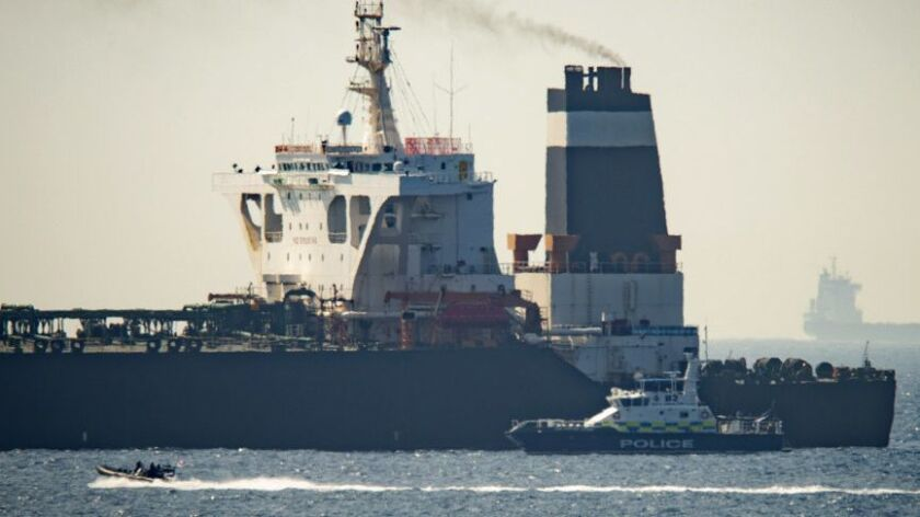 A view of the Grace 1 super tanker i near a Royal Marine patrol vessel in the British territory of G