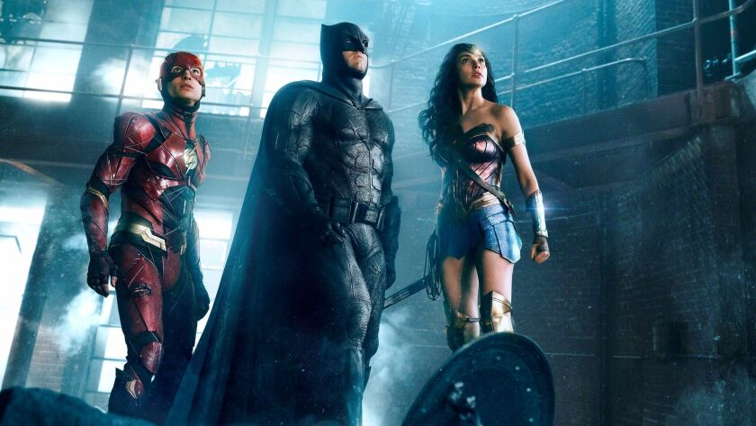"""Ezra Miller, from left, Ben Affleck and Gal Gadot in """"Justice League."""""""