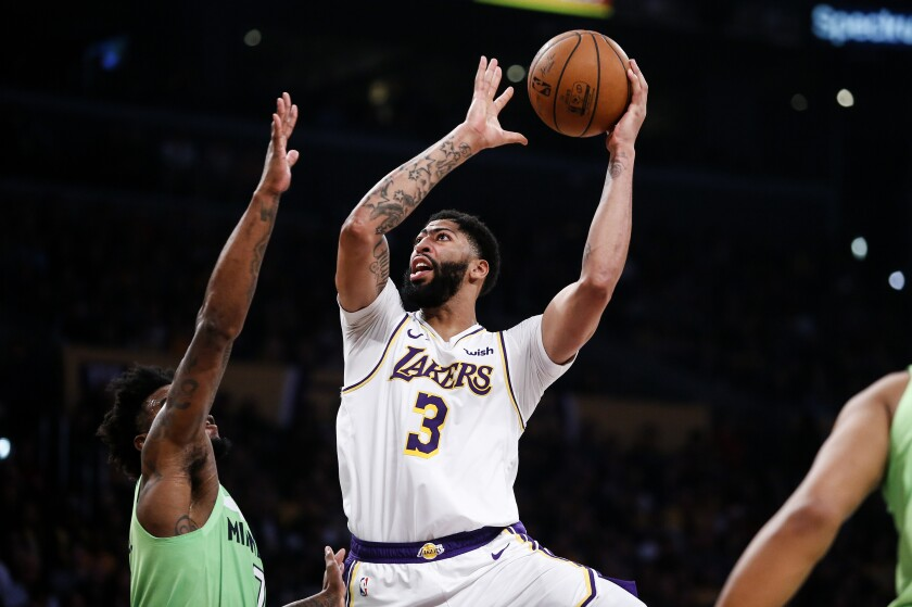 Lakers star Anthony Davis shoots over Minnesota's Jordan Bell.
