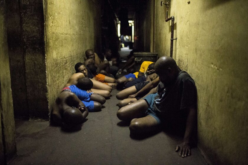 Zulu hostel dwellers wait in a hallway during a joint raid by South African police and the military outside Johannesburg on April 21.
