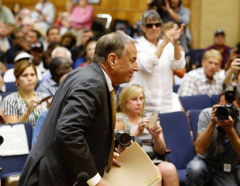 San Diego Mayor Bob Filner enters council chambers Aug. 23 to announce his resignation in the face of sexual-harassment accusations.
