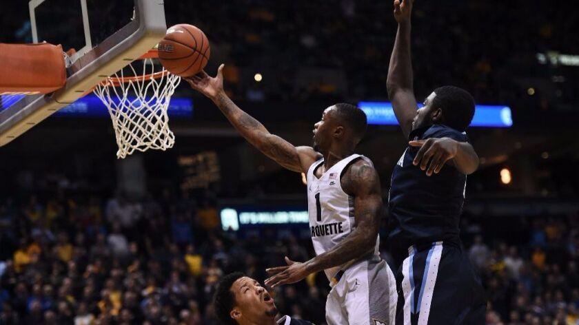 College basketball: No. 1 Villanova falls to Marquette, 74-72
